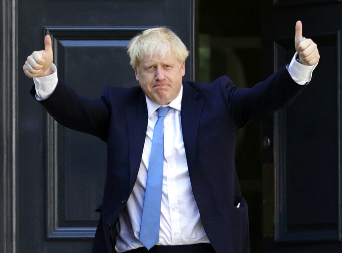 Newly elected leader of the Conservative party Boris Johnson arrives at Conservative party HQ in London, Tuesday, July 23, 2019. Brexit-hard-liner Boris Johnson, one of Britain's most famous and divisive politicians, won the race to lead the governing Conservative Party on Tuesday, and will become the country's next prime minister in a little over 24 hours. (Aaron Chown/PA via AP)