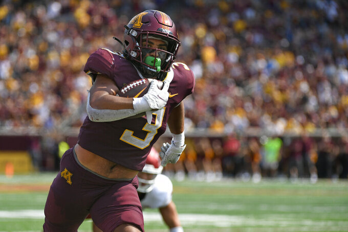 Minnesota running back Treyson Potts runs 21-yards for a touchdown against Miami of Ohio during the second half of an NCAA college football game on Saturday, Sept. 11, 2021, in Minneapolis. Minnesota won 31-26. (AP Photo/Craig Lassig)