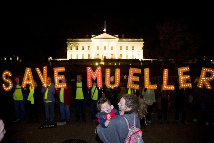 Protesters gather in front of the White House in Washington, Thursday, Nov. 8, 2018, as part of a nationwide