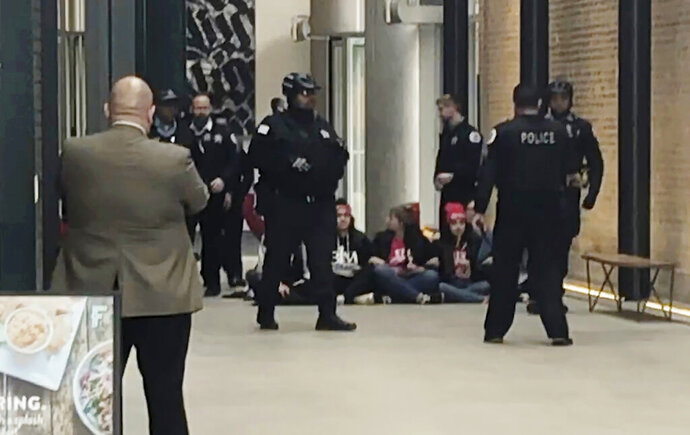 CORRECTS THE SUBJECTS AND THE LOCATION TO POLICE AND STERLING BAY'S HEADQUARTERS - Police surround CTU members protesting inside Sterling Bay's headquarters in Chicago on Tuesday, Oct. 29, 2019. (Mitch Dudek/Chicago Sun-Times via AP)