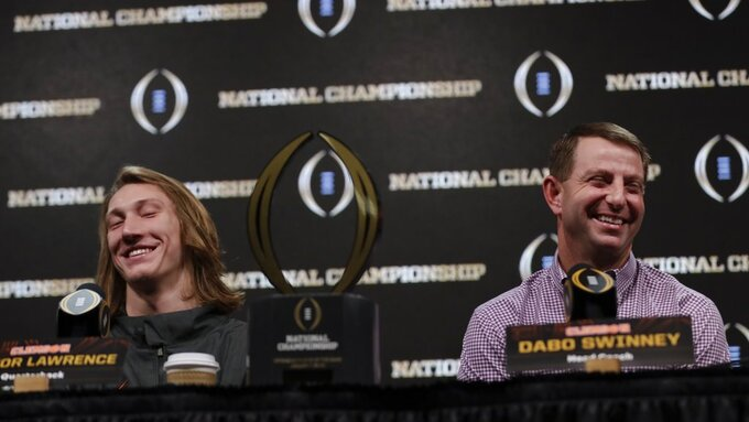 Clemson head coach Dabo Swinney and Trevor Lawrence answer questions at a news conference for the NCAA college football playoff championship game Tuesday, Jan. 8, 2019, in San Jose, Calif. (AP Photo/David J. Phillip)