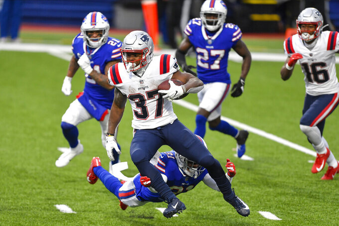 New England Patriots running back Damien Harris (37) breaks a tackle by Buffalo Bills' Dean Marlowe (31) during the second half of an NFL football game Sunday, Nov. 1, 2020, in Orchard Park, N.Y. Harris went on to score a touchdown on the play.(AP Photo/Adrian Kraus)