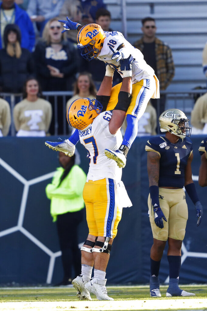 Pittsburgh wide receiver Shocky Jacques-Louis (18) celebrates with offensive lineman Jimmy Morrissey (67) after catching a pass for a touchdown in the first half of an NCAA college football game Saturday, Nov. 2, 2019, in Atlanta. (AP Photo/John Bazemore)