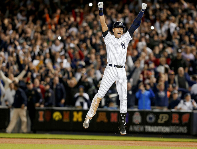 FILE - In this Sept. 25, 2014, file photo, New York Yankees' Derek Jeter jumps after hitting the game-winning single against the Baltimore Orioles in the ninth inning of a baseball game, in New York. Jeter is among 18 newcomers on the 2020 Hall of Fame ballot. On Tuesday, Jan. 21, the Baseball Writers' Association of America will announce the results of its 2020 Hall of Fame balloting. (AP Photo/Julie Jacobson, File)