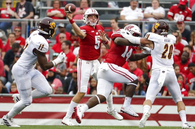 FILE - In this Sept. 7, 2019, file photo, Wisconsin's Graham Mertz throws during the second half of an NCAA college football game against Central Michigan in Madison, Wis. Mertz is about to get his chance to show he's worthy of all the acclaim that accompanied his arrival on campus last year. Now that foot surgery has sidelined returning starter Jack Coan indefinitely, Mertz is likely to open the season as the 16th-ranked Badgers' first-team quarterback. (AP Photo/Morry Gash, File)