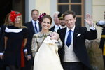 FILE - In this Sunday, Oct. 11, 2015 file photo, Sweden's Princess Madeleine and Christopher O'Neill pose with their son Prince Nicolas after his baptism ceremony, at the Drottningholm Palace Church, near Stockholm, Sweden. As the British royal family wrestles with the future roles of Prince Harry and his wife Meghan, it could look to Europe for examples of how princes and princesses have tried to carve out careers away from the pomp and ceremony of their families' traditional duties. When Christopher O'Neill, a British-American, married Sweden's king Princess Madeleine in 2013, he declined a royal title, so he could continue to work as a financier. (Anders Wiklund/TT News Agency via AP, File)