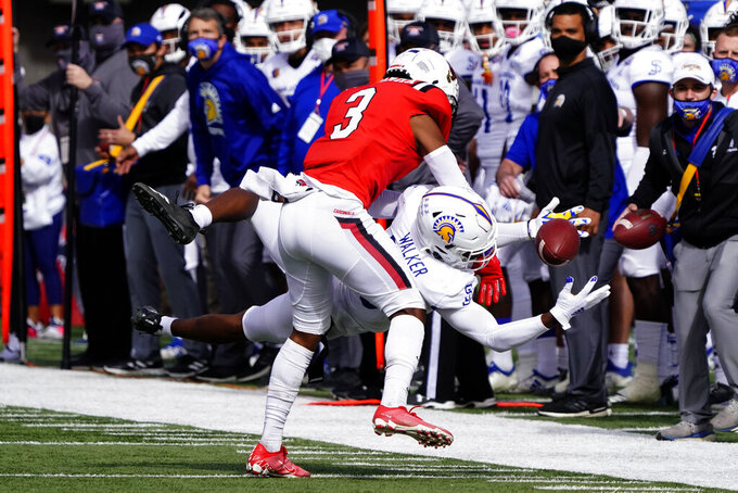 Ball State cornerback Amechi Uzodinma II (3) defends against a pass intended for San Jose State wide receiver Tre Walker in the first half of the Arizona Bowl NCAA college football game, Thursday, Dec. 31, 2020, in Tucson, Ariz. (AP Photo/Rick Scuteri)