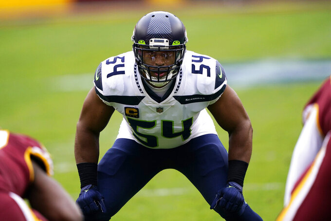 FILE - In his Dec. 20, 2020, file photo, Seattle Seahawks middle linebacker Bobby Wagner looks across the line of scrimmage during the team's NFL football game against the Washington Football Team in Landover, Md. Wagner was named Friday, Jan. 8, 2021, to The Associated Press NFL All-Pro Team, his sixth time on the squad. (AP Photo/Mark Tenally, File)