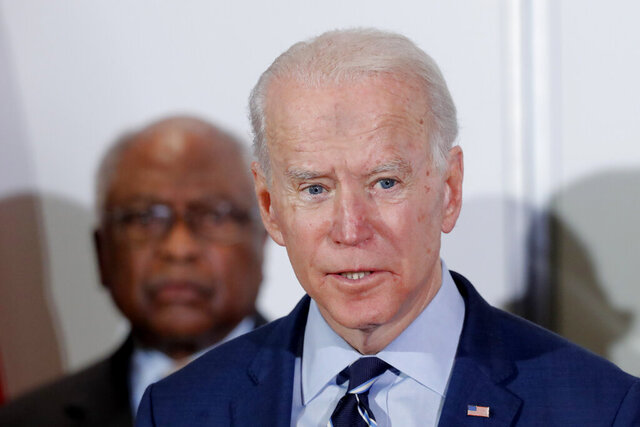 Democratic presidential candidate former Vice President Joe Biden, speaks as he is endorsed by House Majority Whip, Rep. Jim Clyburn, D-S.C., background, in North Charleston, S.C., Wednesday, Feb. 26, 2020. (AP Photo/Gerald Herbert)