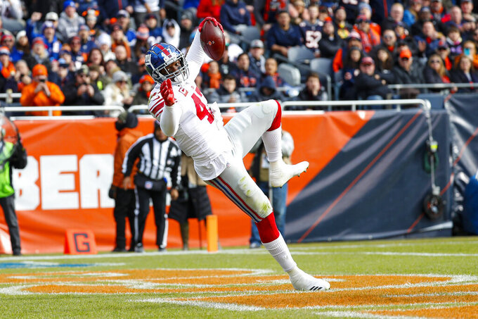 New York Giants outside linebacker Alec Ogletree (47) intercepts a pass in the end zone during the first half of an NFL football game against the Chicago Bears in Chicago, Sunday, Nov. 24, 2019. (AP Photo/Paul Sancya)