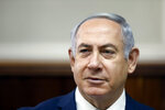 FILE - In this Sunday, Feb. 11, 2018 file photo, Israeli Prime Minister Benjamin Netanyahu chairs the weekly cabinet meeting at the Prime Minister's office in Jerusalem. Israeli media reports Tuesday, Feb. 13, 2018 say police recommending Netanyahu indictment on corruption charges, including bribery. (Ronen Zvulun, Pool via AP, File)