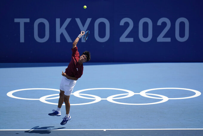 Taro Daniel, of Japan, serves against Lorenzo Sonego, of Italy, during the first round of the tennis competition at the 2020 Summer Olympics, Saturday, July 24, 2021, in Tokyo, Japan. (AP Photo/Seth Wenig)