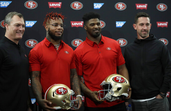 From left, San Francisco 49ers General Manager John Lynch, Kwon Alexander, Dee Ford and coach Kyle Shanahan stand for a photo following an NFL news conference Thursday, March 14, 2019, in Santa Clara, Calif. (AP Photo/Ben Margot)