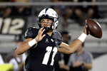Central Florida quarterback Dillon Gabriel (11) throws a pass during the first half of an NCAA college football game against Connecticut, Saturday, Sept. 28, 2019, in Orlando, Fla. (AP Photo/Phelan M. Ebenhack)