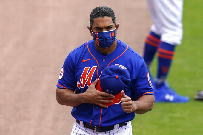 New York Mets manager Luis Rojas gives a thumbs-up during a spring training baseball game against the Washington Nationals, Thursday, March 4, 2021, in Port St. Lucie, Fla. (AP Photo/Lynne Sladky)