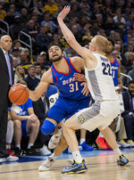 DePaul guard Max Strus, left, is defended by Marquette forward Joey Hauser, right during the second half of an NCAA college basketball game, Wednesday, Jan. 23, 2019, in Milwaukee. (AP Photo/Darren Hauck)