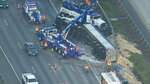 In this Wednesday, May 23, 2018, aerial photo provided by KOMOnews.com, chicken feathers cover the ground alongside Interstate 5 in Federal Way, Wash. A tractor-trailer made a fowl mess when it rolled over, dumping about 40,000 pounds of chicken feathers across the freeway. Washington State Patrol Trooper Rick Johnson says the driver told investigators he fell asleep at about 3:30 a.m. north of Tacoma and lost control of the truck, which hit a guardrail and overturned. The truck was hauling the feathers from a poultry facility to a rendering company in Vancouver, British Columbia. (Air 4/KOMOnews.com via AP)