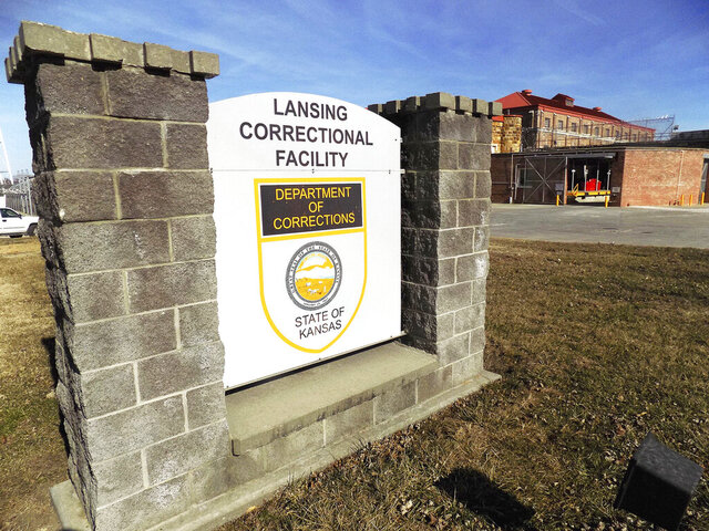 FILE - This Feb. 2, 2017, file photo, shows the exterior of the Lansing Correctional Center in Lansing, Kan. A coronavirus outbreak that has sickened hundreds of people at the largest prison in Kansas has claimed the life of a staff member, the state Corrections Department said Tuesday May 12, 2020. Department spokeswoman Rebecca Witte said the Lansing Correctional Facility employee died Monday, but she provided no additional information.  (Mark Rountree/Leavenworth Times via AP, File)
