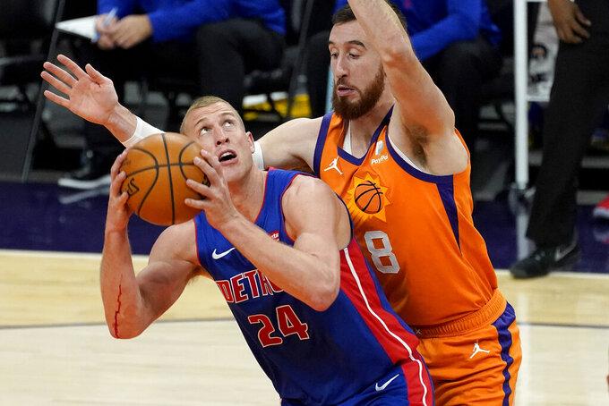 Detroit Pistons center Mason Plumlee (24) tries to shoot over Phoenix Suns forward Frank Kaminsky (8) during the first half of an NBA basketball game, Friday, Feb. 5, 2021, in Phoenix. (AP Photo/Matt York)