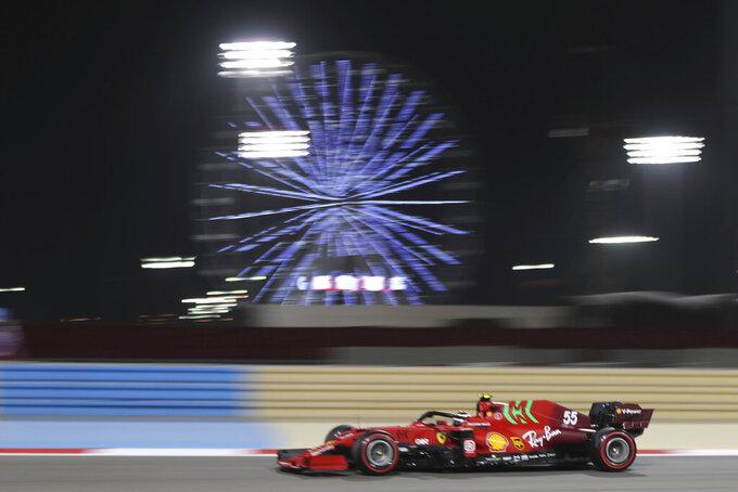 Ferrari driver Carlos Sainz of Spain steers his car during the second free practice at the Formula One Bahrain International Circuit in Sakhir, Bahrain, Friday, March 26, 2021. The Bahrain Formula One Grand Prix will take place on Sunday. (AP Photo/Kamran Jebreili)