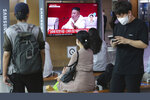 People watch a screen showing a file image of North Korean leader Kim Jong Un during a news program at the Seoul Railway Station in Seoul, South Korea, Friday, Sept. 25, 2020. Kim apologized Friday over the killing of a South Korea official near the rivals' disputed sea boundary, saying he's
