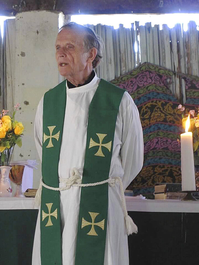 This 2013 photo provided to The Associated Press shows now-defrocked Catholic priest Richard Daschbach leading a service at a church in Kutet, East Timor. The church defrocked Daschbach in 2018, saying he had confessed to sexually abusing children. But he has widespread support, including backing from a former president of East Timor, who is also an independence hero. (AP Photo)