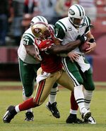 FILE - In this Sunday, Dec. 7, 2008, file photo, New York Jets quarterback Brett Favre is sacked by San Francisco 49ers linebacker Parys Haralson during the fourth quarter of an NFL football game in San Francisco. On Monday, Sept. 13, 2021, the San Francisco 49ers announced that Haralson, a former linebacker for the 49ers and New Orleans Saints, had died. He was 37. (AP Photo/Marcio Jose Sanchez, File)