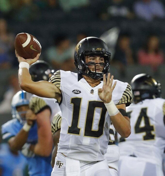 FILE - In this Aug. 30, 2018, file photo, Wake Forest quarterback Sam Hartman throws a pass during the first half of an NCAA college football game against Tulane, in New Orleans. No Wake Forest quarterback had a better starting debut than Sam Hartman. The freshman wants to keep it going in Week 2.  The Demon Deacons (1-0) play host to Towson (1-0) of the FCS on Saturday, Sept. 8. (AP Photo/Veronica Dominach)
