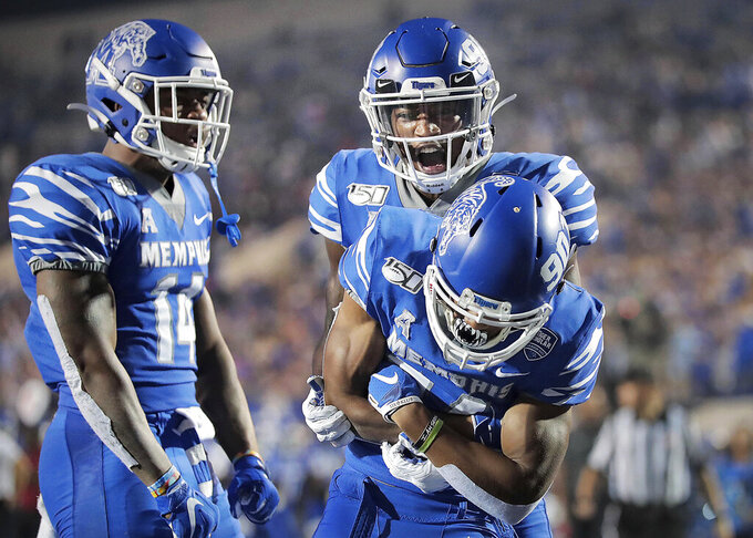 Memphis receiver Calvin Austin III, right front, celebrates a touchdown with Damonte Coxie and Antonio Gibson, left, during an NCAA college football game against Tulane on Saturday, Oct. 19, 2019, in Memphis, Tenn. (Jim Weber/Daily Memphian via AP)