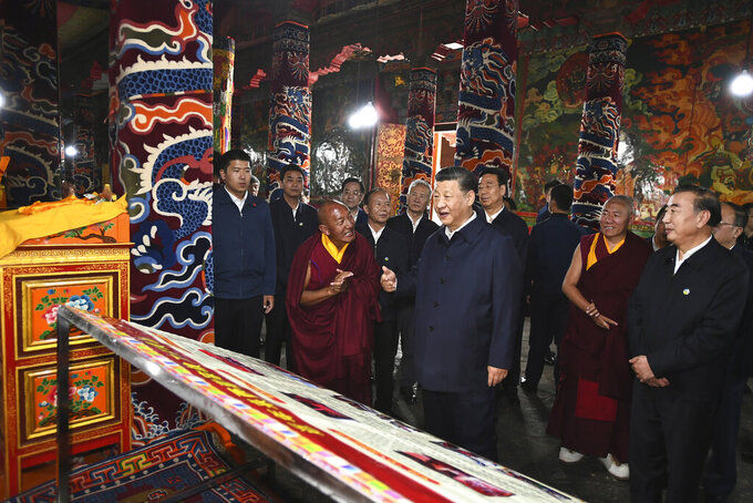 In this July 22, 2021 photo released by China's Xinhua News Agency, Chinese President Xi Jinping, center, visits the Drepung Monastery near Lhasa in western China's Tibet Autonomous Region. Chinese leader Xi Jinping has made a rare visit to Tibet as authorities tighten controls over the Himalayan region's traditional Buddhist culture, accompanied by an accelerated drive for economic development. (Xie Huanchi/Xinhua via AP)