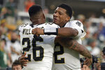 New Orleans Saints cornerback P.J. Williams (26) hugs quarterback Jameis Winston (2) after they defeated the Green Bay Packers in an NFL football game, Sunday, Sept. 12, 2021, in Jacksonville, Fla. (AP Photo/Phelan M. Ebenhack)