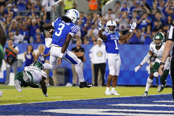 Kentucky quarterback Terry Wilson (3) scores a touchdown during the second half of an NCAA college football game between Kentucky and Eastern Michigan, Saturday, Sept. 7, 2019, in Lexington, Ky. (AP Photo/Bryan Woolston)