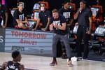 Miami Heat's Meyers Leonard, right front, cheers on his team during the first half of an NBA conference final playoff basketball game against the Boston Celtics on Saturday, Sept. 19, 2020, in Lake Buena Vista, Fla. (AP Photo/Mark J. Terrill)