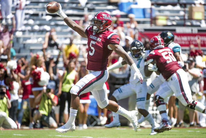 South Carolina running back Rico Dowdle (5) scores a touchdown against Coastal Carolina during the first half of an NCAA college football game Saturday, Sept. 1, 2018, in Columbia, S.C. (AP Photo/Sean Rayford)