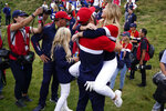 Team USA's Dustin Johnson celebrates with Paulina Gretzky after the Ryder Cup matches at the Whistling Straits Golf Course Sunday, Sept. 26, 2021, in Sheboygan, Wis. (AP Photo/Ashley Landis)