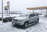 Snow accumulates on a recently parked car at a gas station and fast food restaurant on Friday, Jan. 12, 2018, in Parkers Crossroads, Tenn. (AP Photo/Adrian Sainz)