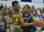 Buffalo guard CJ Massinburg (5) drives against Kent State guard Antonio Williams during the first half of an NCAA college basketball game, Friday, Jan. 25, 2019, in Kent, Ohio. (AP Photo/David Dermer)