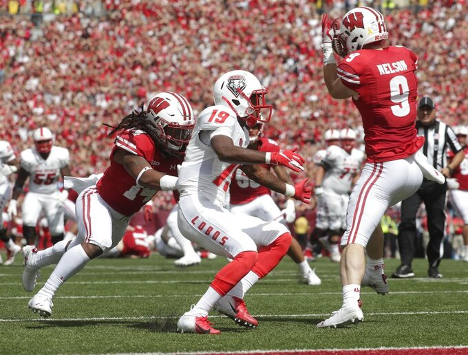 Wisconsin's Scott Nelson intercepts a pass during the second half of an NCAA college football game against New Mexico Saturday, Sept. 8, 2018, in Madison, Wis. Wisconsin won 45-14. (AP Photo/Morry Gash)