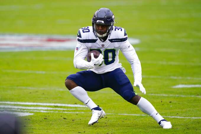 Seattle Seahawks running back Carlos Hyde (30) runs with the ball during the first half of an NFL football game against the Washington Football Team, Sunday, Dec. 20, 2020, in Landover, Md. (AP Photo/Susan Walsh)