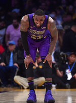 Los Angeles Lakers forward LeBron James winces after falling during the second half of an NBA basketball game against the Brooklyn Nets Friday, March 22, 2019, in Los Angeles. The Nets won 111-106. (AP Photo/Mark J. Terrill)