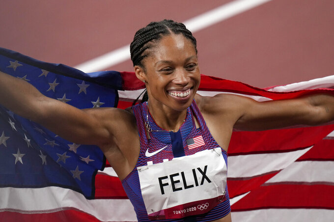 Allyson Felix, of United States smiles after taking the bronze, in the final of women's 400-meters at the 2020 Summer Olympics, Friday, Aug. 6, 2021, in Tokyo, Japan. (AP Photo/Francisco Seco)