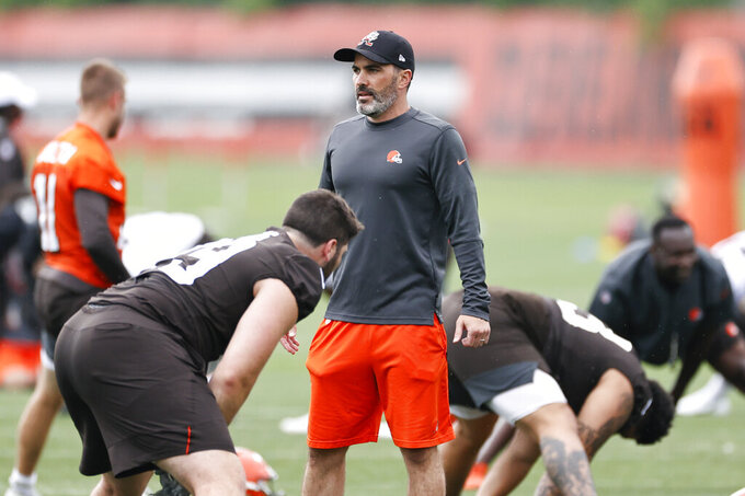 Cleveland Browns head coach Kevin Stefanski watches the team warm up during NFL football practice at the team's training facility, Wednesday, June 2, 2021, in Berea, Ohio. (AP Photo/Ron Schwane)