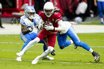 FILE - In this  Sunday, Sept. 27, 2020 file photo, Arizona Cardinals wide receiver DeAndre Hopkins (10) is hit by Detroit Lions outside linebacker Christian Jones during the first half of an NFL football game in Glendale, Ariz. Buffalo's Stefon Diggs and Arizona's DeAndre Hopkins are two receivers who have flourished in their new homes after being traded to their respective teams just hours apart in March. The Bills travel to face the Cardinals in a game that's vital for both teams in their chase for the playoffs, Sunday, Nov. 15, 2020. (AP Photo/Ross D. Franklin, File)