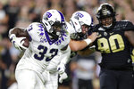 TCU running back Sewo Olonilua (33) carries against Purdue during the second half of an NCAA college football game in West Lafayette, Ind., Saturday, Sept. 14, 2019. (AP Photo/Michael Conroy)