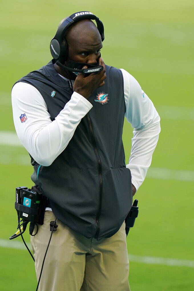 Miami Dolphins head coach Brian Flores looks down field, during the second half of an NFL football game against the Buffalo Bills, Sunday, Sept. 20, 2020 in Miami Gardens, Fla. The Bills defeated the Dolphins 31-28. (AP Photo/Wilfredo Lee)