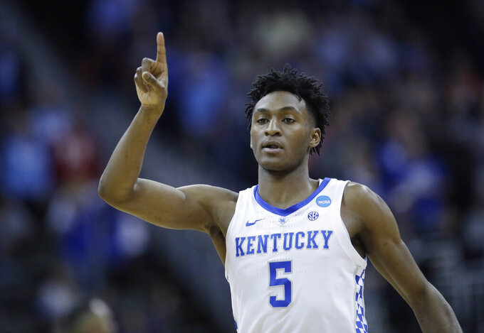 Kentucky's Immanuel Quickley celebrates during the second half of a men's NCAA tournament college basketball Midwest Regional semifinal game against Houston, Friday, March 29, 2019, in Kansas City, Mo. (AP Photo/Charlie Riedel)
