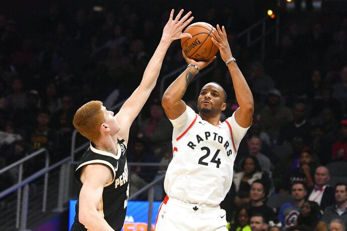 Toronto Raptors guard Norman Powell (24) shoots as Atlanta Hawks guard Kevin Huerter defends during the second half of an NBA basketball game Monday, Jan. 20, 2020, in Atlanta. Toronto won 122-117. (AP Photo/John Amis)