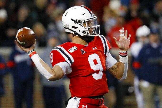 Cincinnati quarterback Desmond Ridder passes during the second half of an NCAA college football game against Connecticut, Saturday, Nov. 9, 2019, in Cincinnati. (AP Photo/John Minchillo)