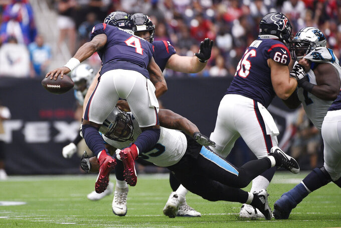 Houston Texans quarterback Deshaun Watson (4) is pressured by Carolina Panthers defensive end Bruce Irvin (55) during the first half of an NFL football game Sunday, Sept. 29, 2019, in Houston. (AP Photo/Eric Christian Smith)