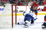 Washington Capitals left wing Carl Hagelin (62) scores a goal against Tampa Bay Lightning goaltender Andrei Vasilevskiy (88), of Russia, during the second period of an NHL hockey game Wednesday, March 20, 2019, in Washington. (AP Photo/Nick Wass)